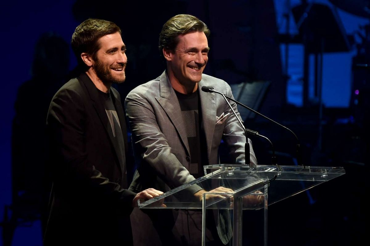 Jake Gyllenhaal (left) and Jon Hamm speaking during the Stronger Together fund-raiser, in support of Democratic presidential candidate Hillary Clinton, at St James Theatre in New York on Oct 17, 2016.