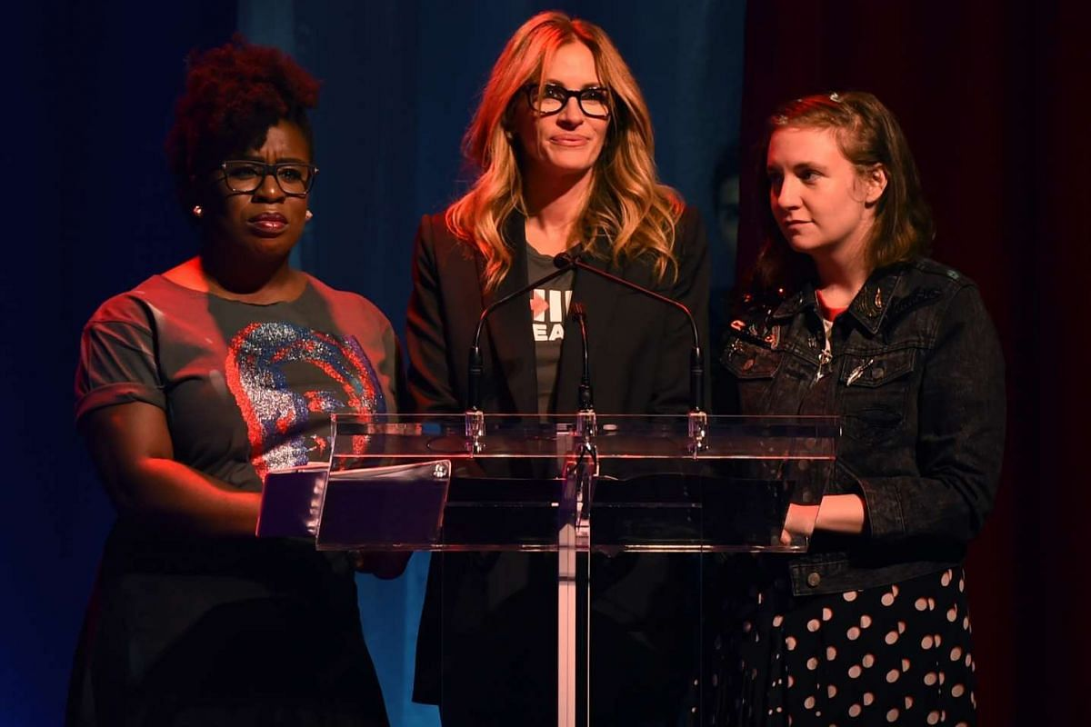 (From left) Uzo Aduba, Julia Roberts and Lena Dunham speaking during the Stronger Together fund-raiser, in support of Democratic presidential candidate Hillary Clinton, at St James Theatre in New York on Oct 17, 2016.