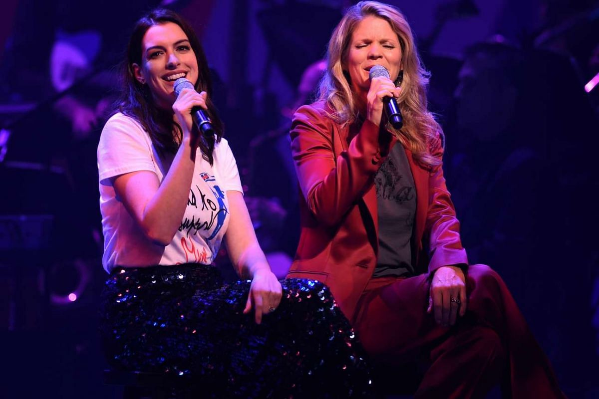 Anne Hathaway (left) and Kelli O'Hara performing during the Stronger Together fund-raiser, in support of Democratic presidential candidate Hillary Clinton, at St James Theatre in New York on Oct 17, 2016.