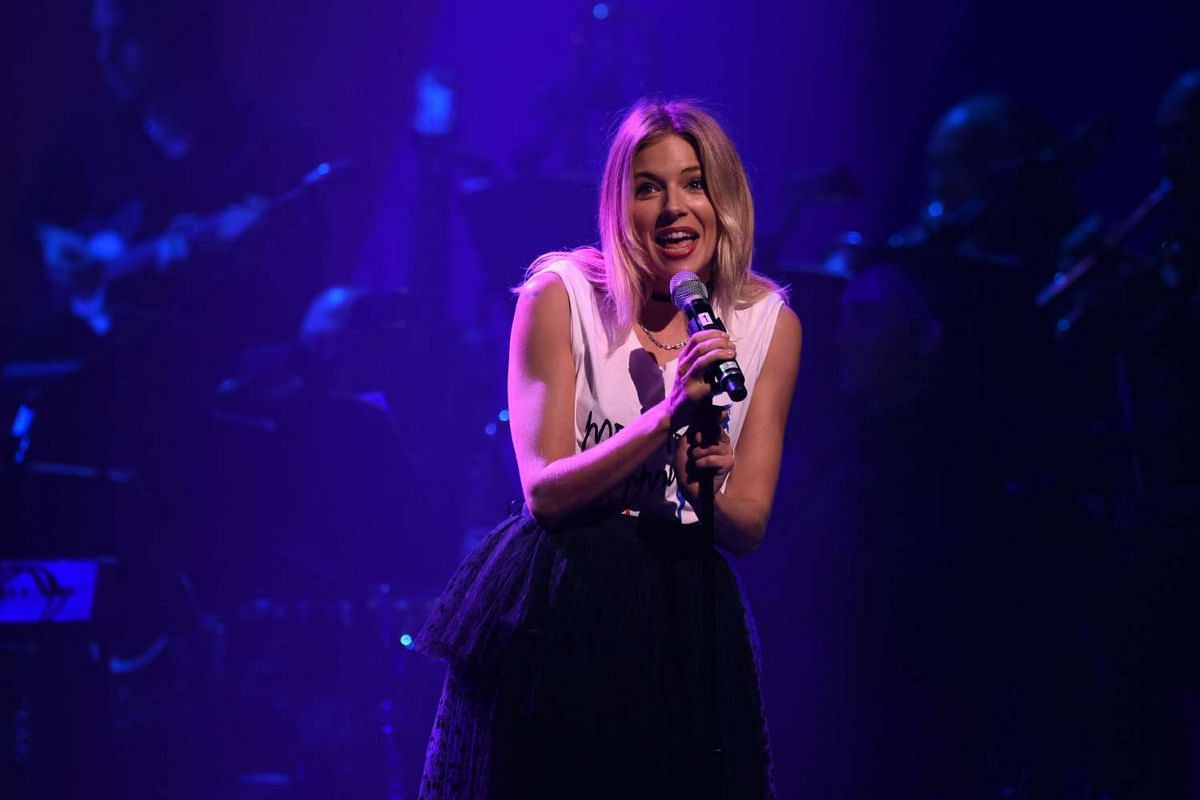 Sienna Miller singing during the Stronger Together fund-raiser, in support of Democratic presidential candidate Hillary Clinton, at St James Theatre in New York on Oct 17, 2016.