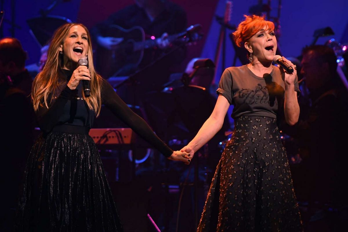 Sarah Jessica Parker (left) and Andrea McArdle performing during the Stronger Together fund-raiser, in support of Democratic presidential candidate Hillary Clinton, at St James Theatre in New York on Oct 17, 2016.