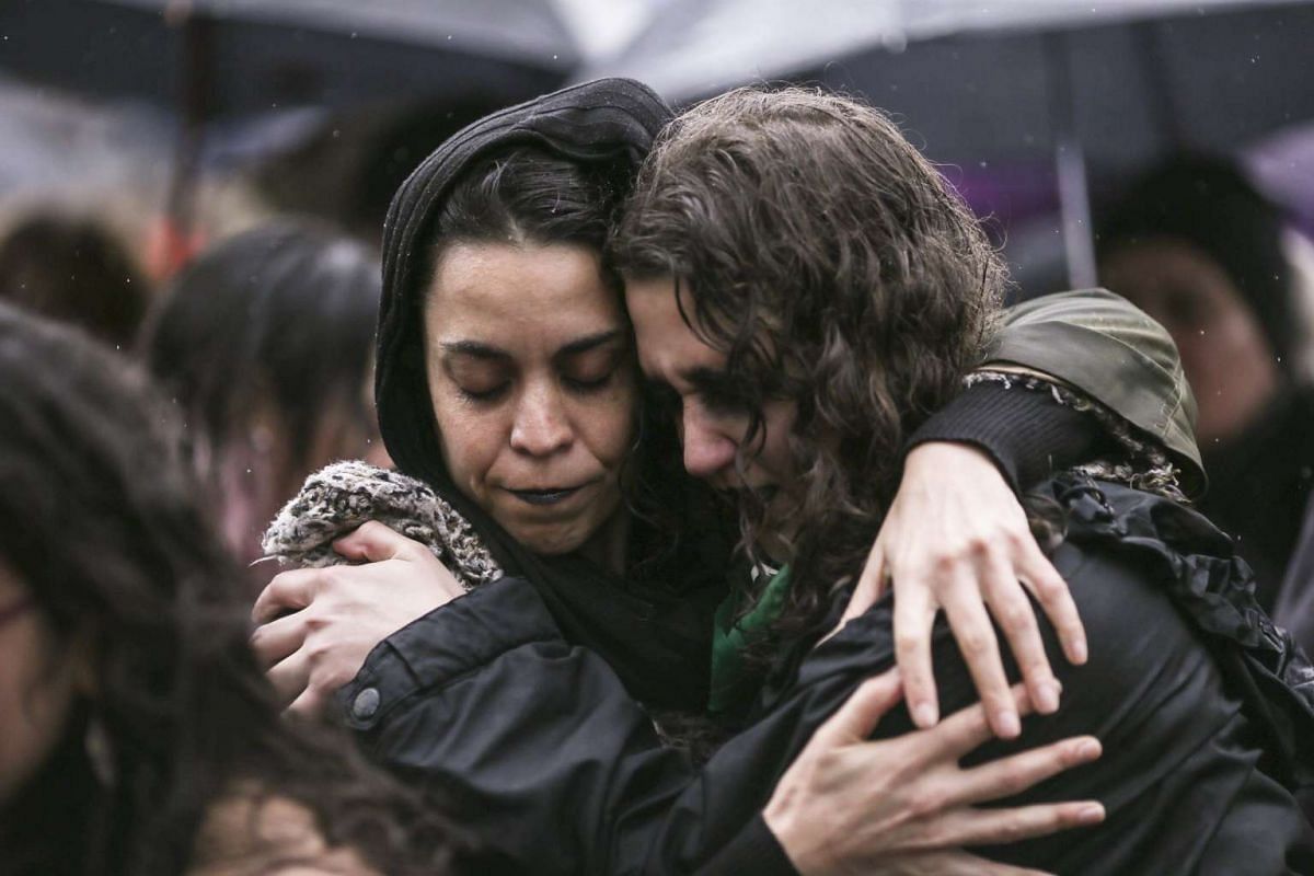 Thousands of people participate in the 'Black Wednesday' march in Buenos Aires, Argentina on October 19,  2016, a day that seeks to put an end to gender violence and other discrimination practices against women, after the violent rape and murder of a
