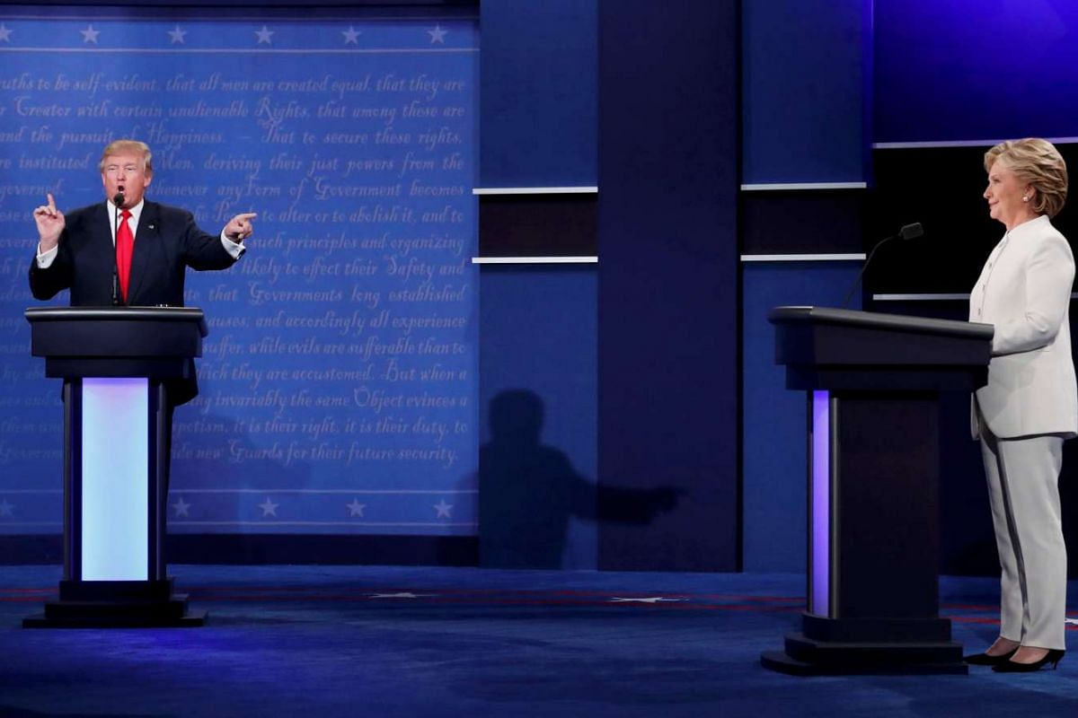 Republican U.S. presidential nominee Donald Trump speaks as Democratic nominee Hillary Clinton listens during their third and final 2016 presidential campaign debate at UNLV in Las Vegas, Nevada, U.S., October 19, 2016. PHOTO: REUTERS
