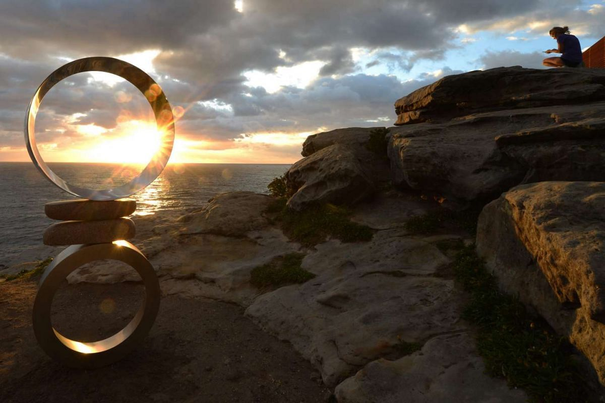 A sculpture made from stainless steel and stone is seen on display between Bondi Beach and Tamarama Beach on the first day of the Sculpture by the Sea exhibition in Sydney on October 20, 2016. PHOTO: AFP