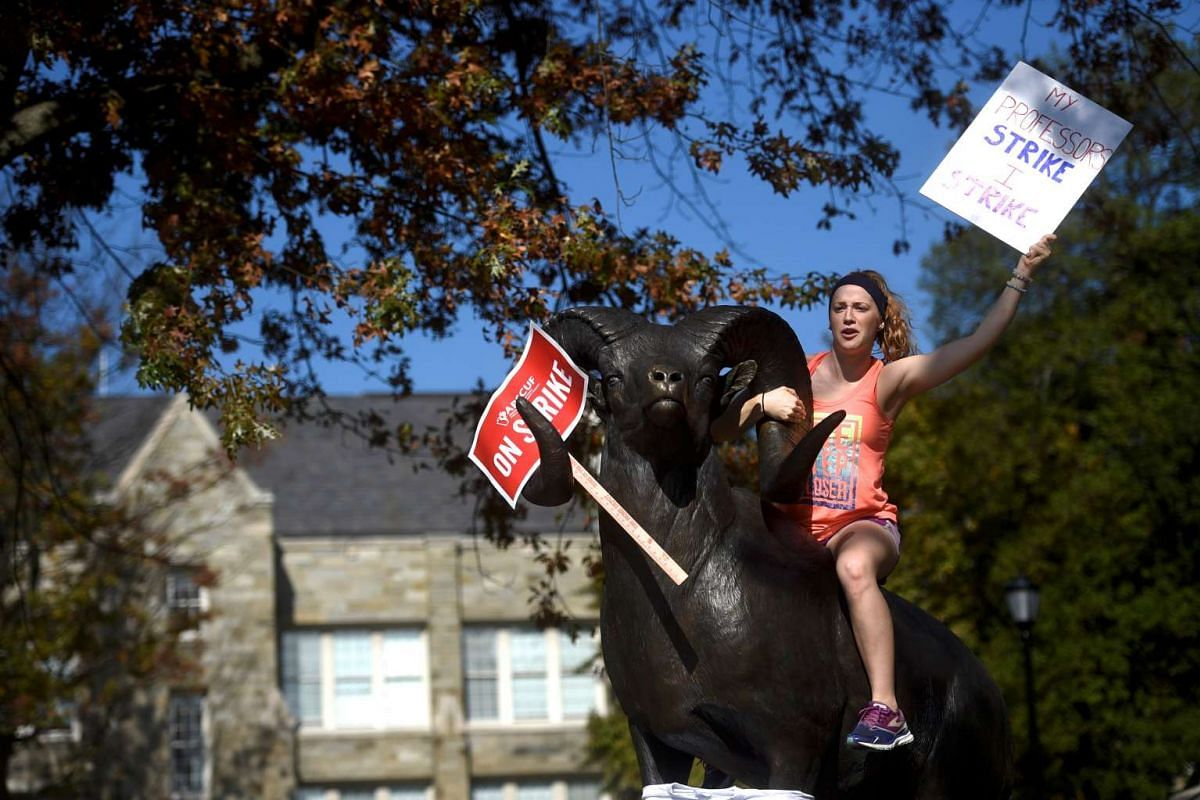 Grace Crowley, a West Chester University senior, demonstrates with university employees from the APSCUF union representing 5,500 Pennsylvania university and college employees after failing to reach a contract deal with the state education system in W