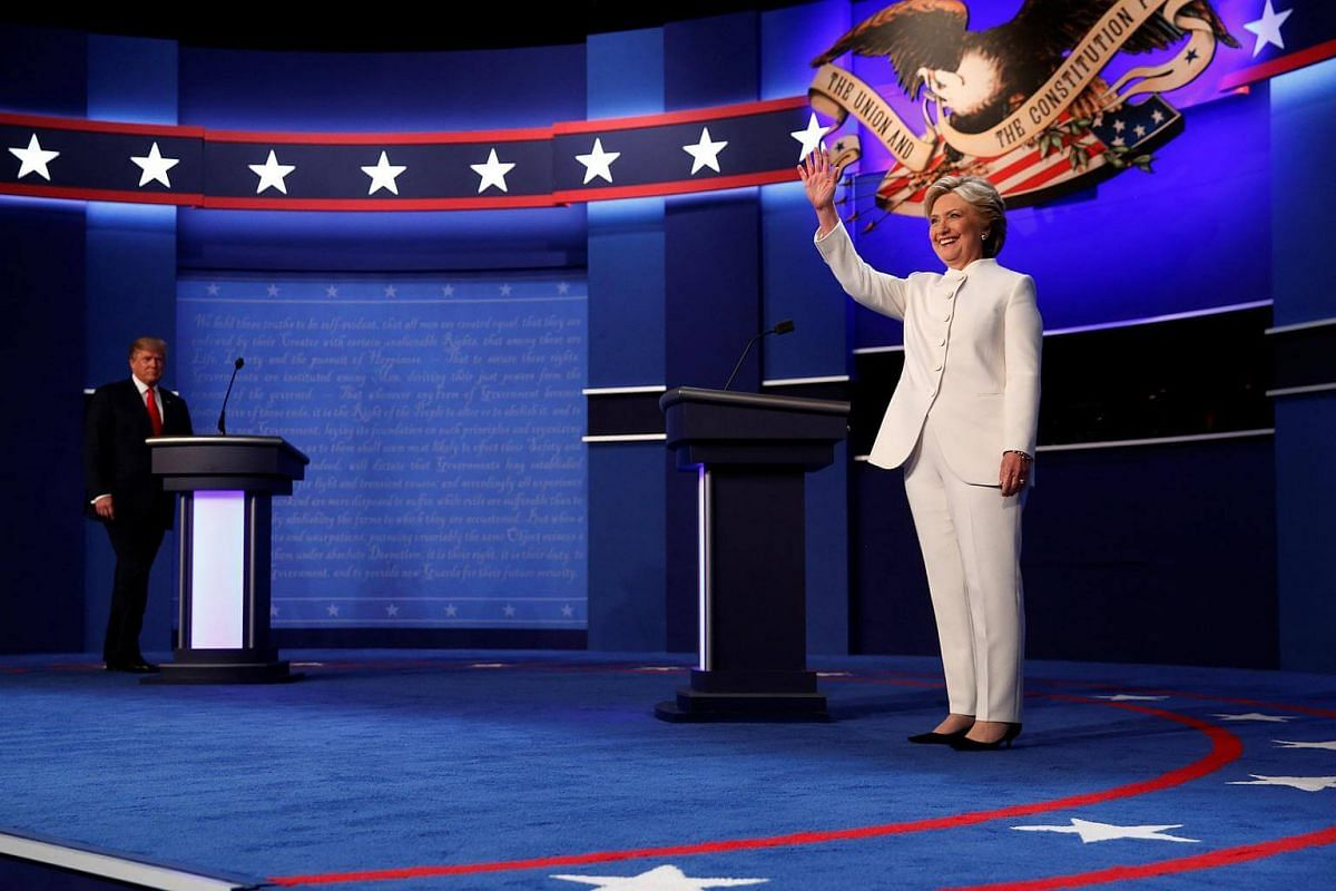 Mr Donald Trump and Mrs Hillary Clinton walk onstage to begin their third and final 2016 US presidential debate in Las Vegas, Nevada.