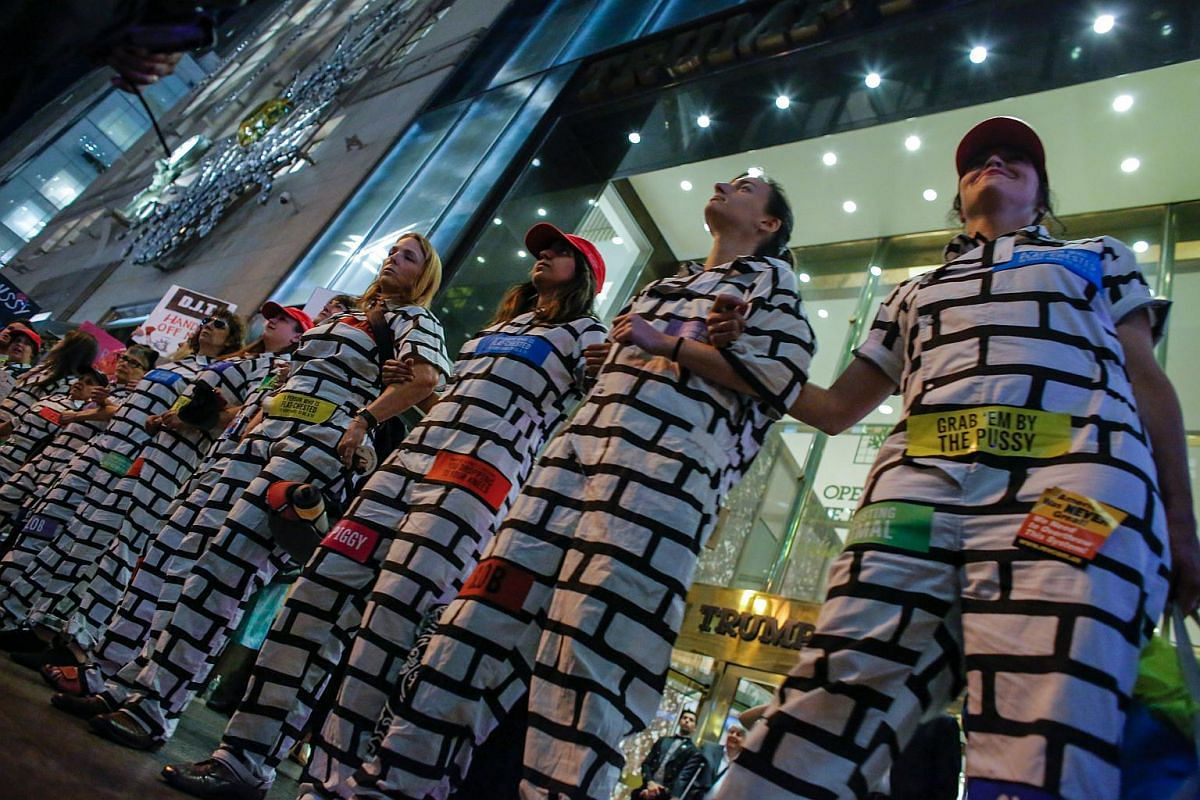 A group of women dress up as a Wall take part of a protest outside the Trump Tower to Protest against Republican presidential candidate Donald Trump for his Treatment of Women in New York on Oct 19, 2016.