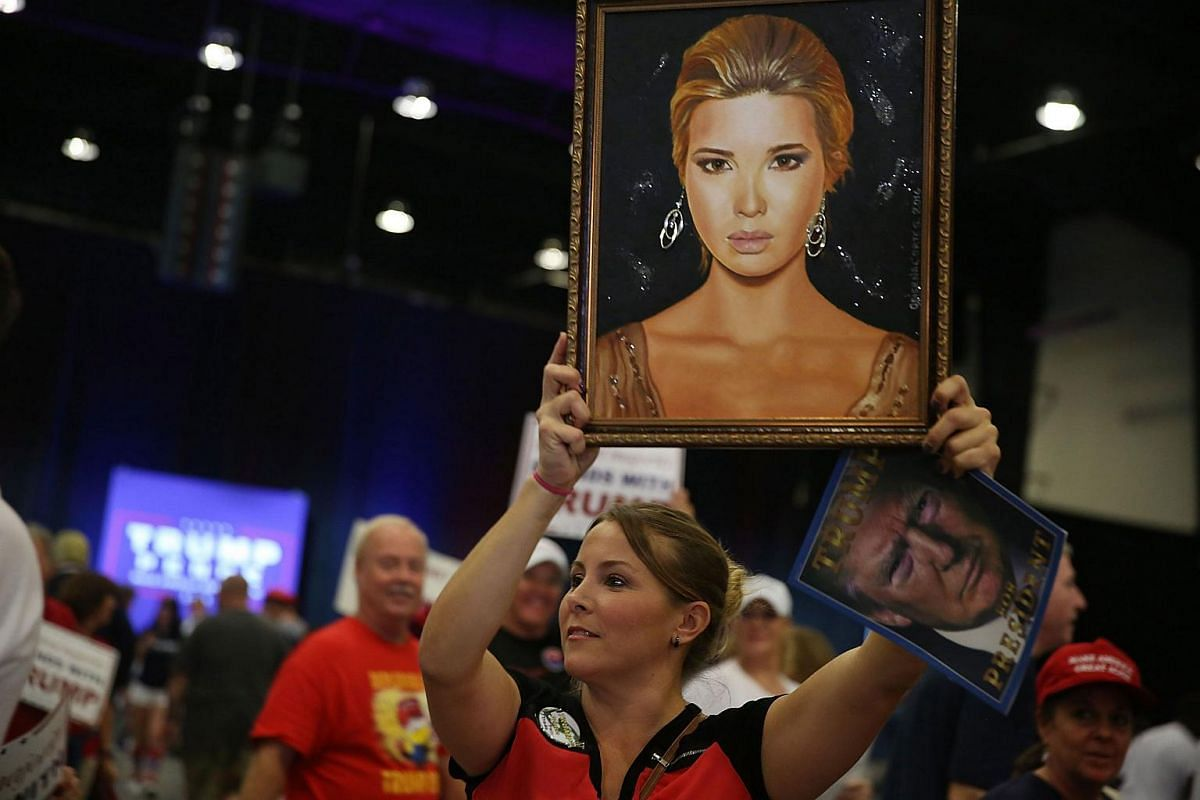 A painting of Ivanka Trump is held up during a campaign rally for her father, Republican presidential candidate Donald Trump, at the South Florida Fair Expo Center on Oct 13, 2016, in West Palm Beach, Florida.
