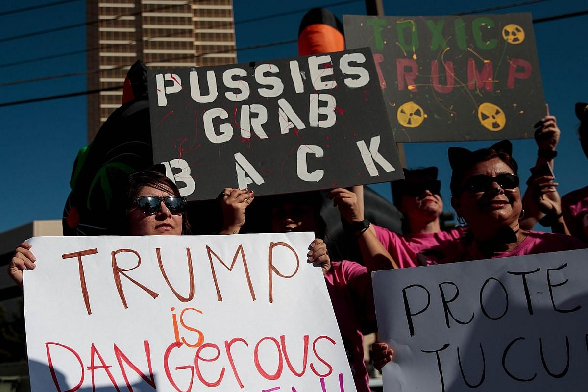 Activists and volunteers from Planned Parenthood rally against Republican presidential candidate Donald Trump across the street from the Trump International Hotel Las Vegas, October 18, 2016 in Las Vegas, Nevada