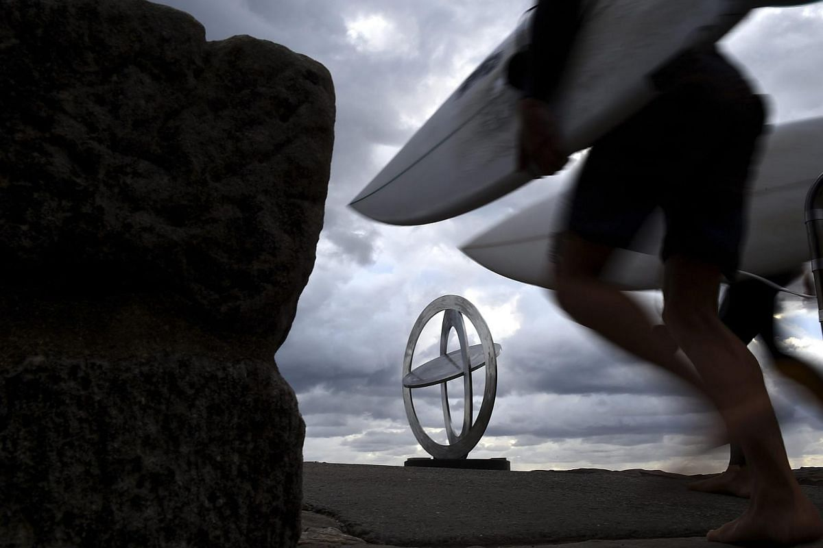 'Celestial Rings I' by Australian artist Inge King is seen on display at the annual Sculpture by the Sea exhibitoin along the Bondi to Tamarama coastal walk in Sydney.