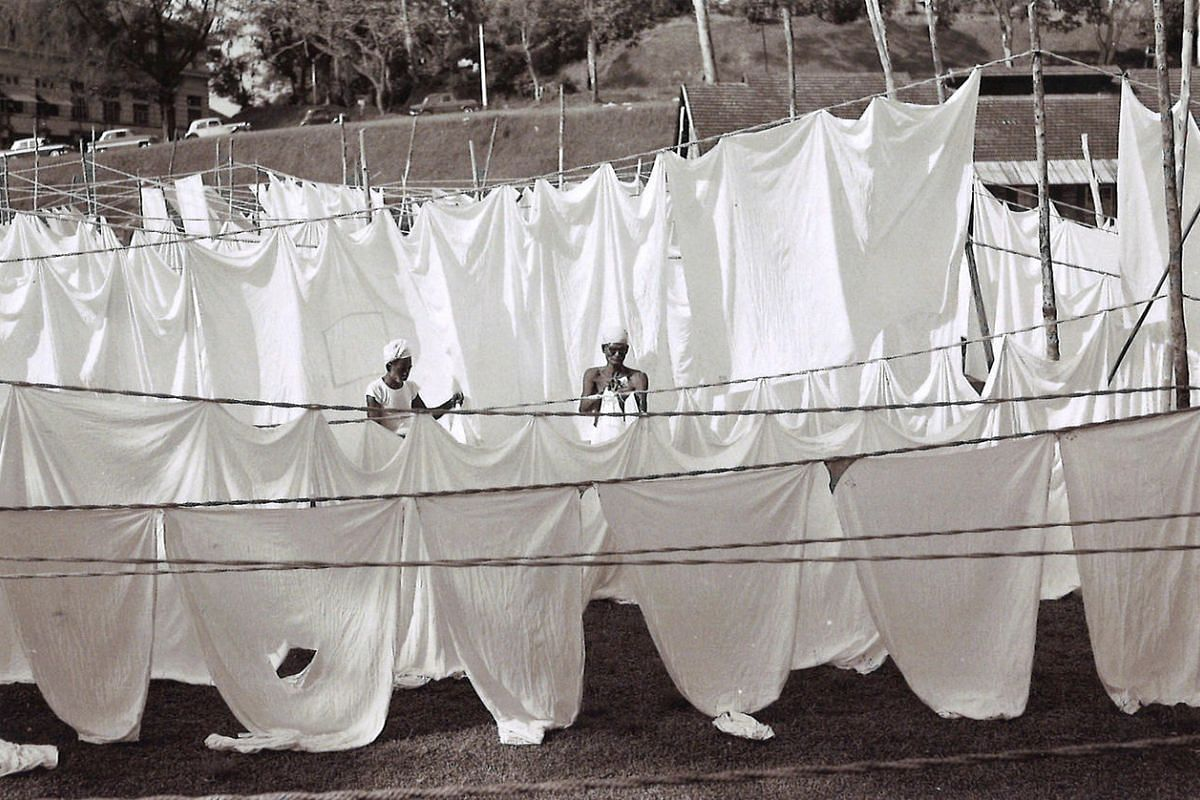 Workers hanging sheets to dry at Outram Road in Singapore in the 1960s or 70s.