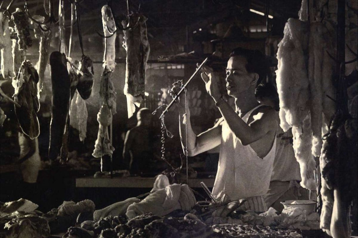 A man selling pork at the Teochew Market, taken in Singapore in the 1960s or 70s.
