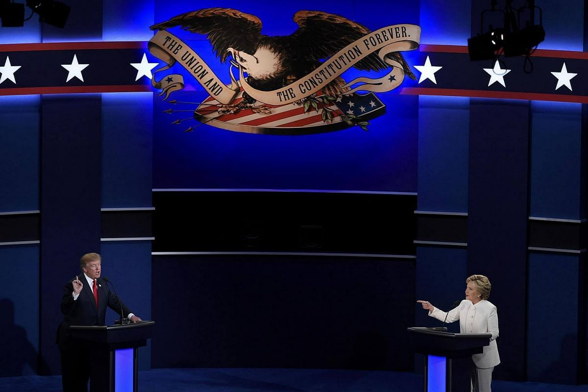 Mr Donald Trump and Mrs Hillary Clinton on stage in their third and final 2016 presidential debate in Las Vegas, Nevada.