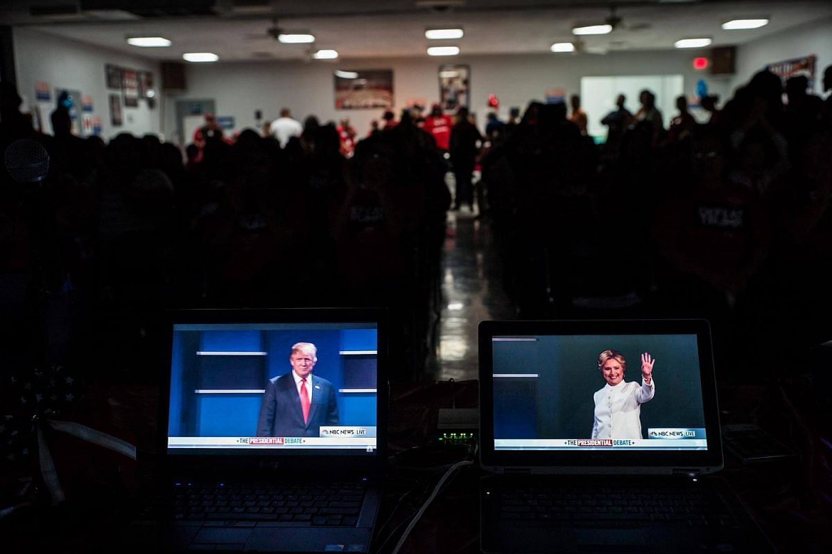Monitors show Mr Donald Trump and Mrs Hillary Clinton during a debate watch party held by the Culinary Workers Union in Las Vegas. The union has endorsed Mrs Clinton for president.