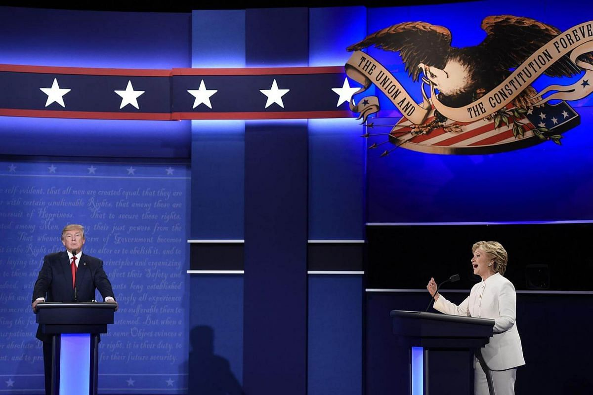 Mr Donald Trump and Mrs Hillary Clinton debate during the final presidential debate in Las Vegas, Nevada on Oct 19, 2016.