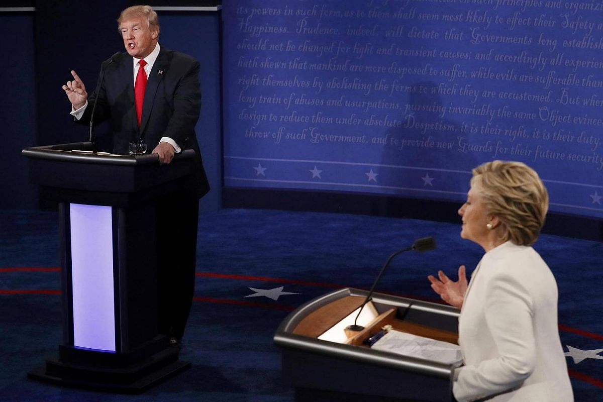 Mr Donald Trump and Mrs Hillary Clinton speak during their third and final 2016 presidential campaign debate in Las Vegas, Nevada.