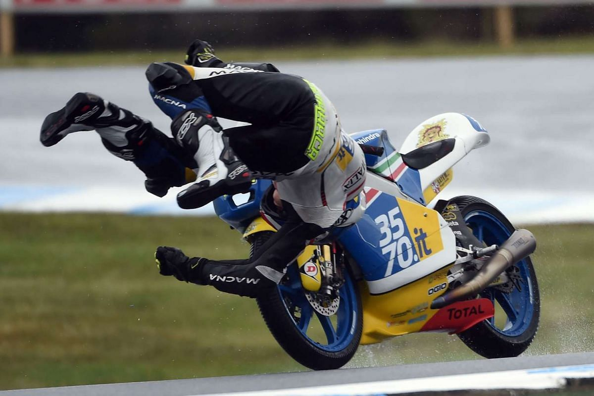 3570 Team Italia's Italian rider Lorenzo Petrarca crashes out during the first practice session of the Moto 3 ahead of 2016 Australian Grand Prix at Phillip Island on October 21, 2016. PHOTO: AFP
