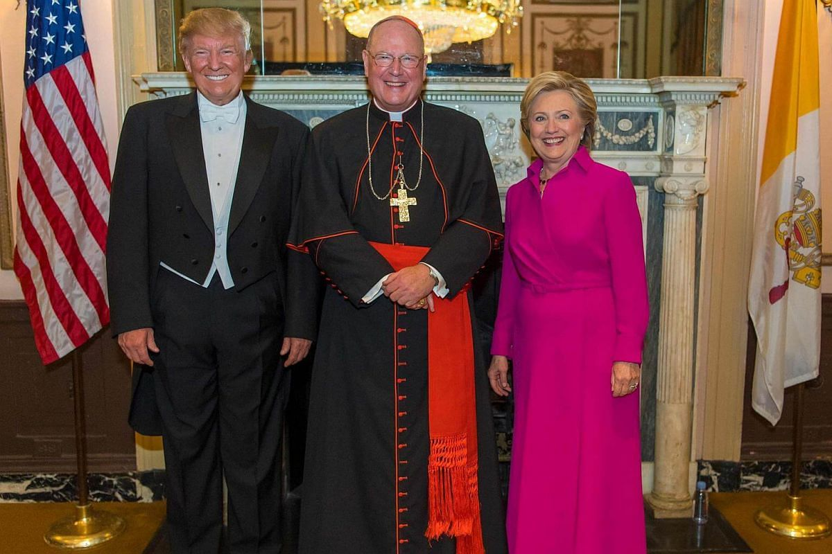 His Eminence Cardinal Timothy Dolan poses with Democratic presidential nominee Hillary Clinton and Republican presidential nominee Donald Trump at the 71st Annual Alfred E. Smith Foundation Dinner at the Waldorf Astoria hotel in New York on Oct 20, 2