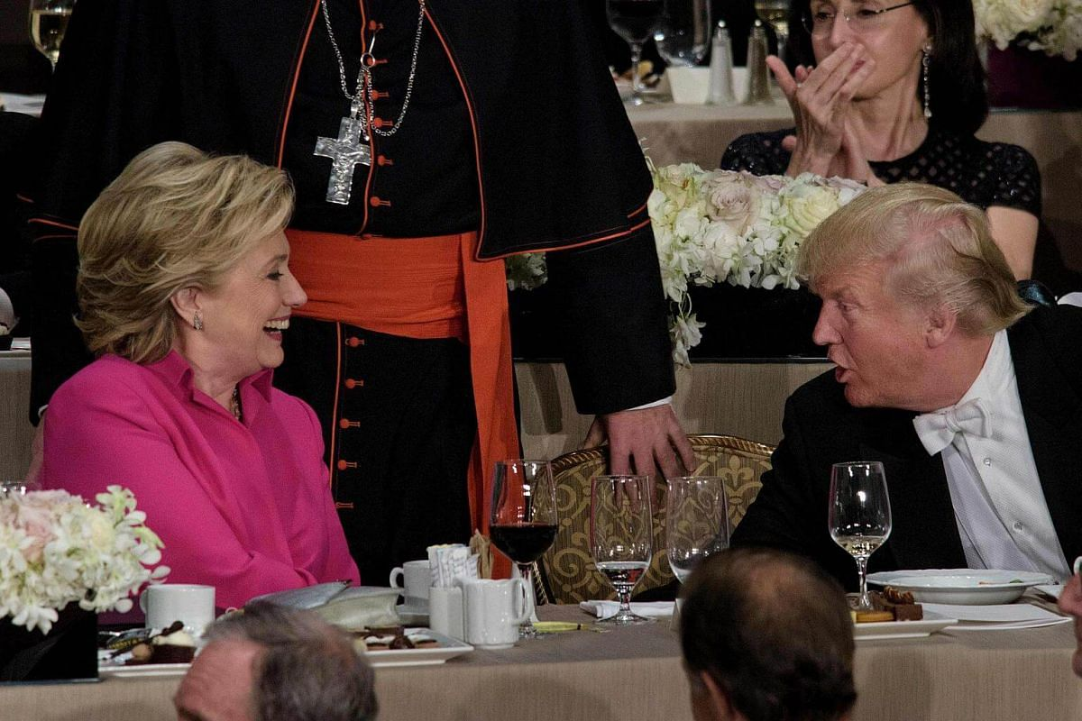 Democratic presidential nominee Hillary Clinton and Republican presidential nominee Donald Trump shake hands after speaking during the Alfred E. Smith Memorial Foundation Dinner at Waldorf Astoria on Oct 20, 2016.