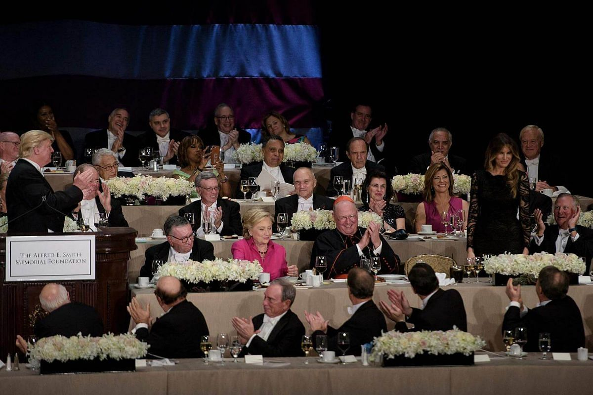Republican presidential nominee Donald Trump and others clap for Mrs Melania Trump during the Alfred E. Smith Memorial Foundation Dinner at Waldorf Astoria on Oct 20, 2016.