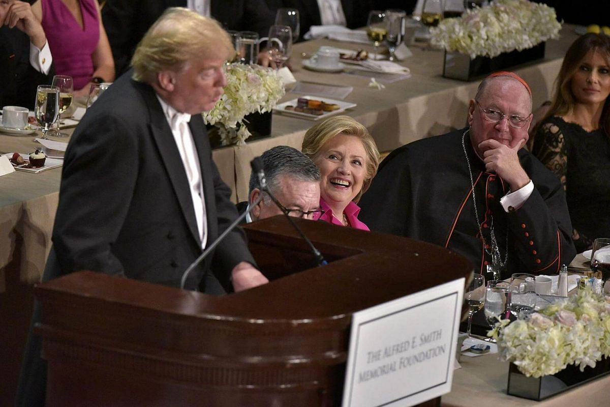 Democratic presidential nominee Hillary Clinton laughs as Republican presidential nominee Donald Trump speaks during the 71st annual Alfred E. Smith Memorial Foundation Dinner at the Waldorf-Astoria Hotel in New York on Oct 20, 2016.