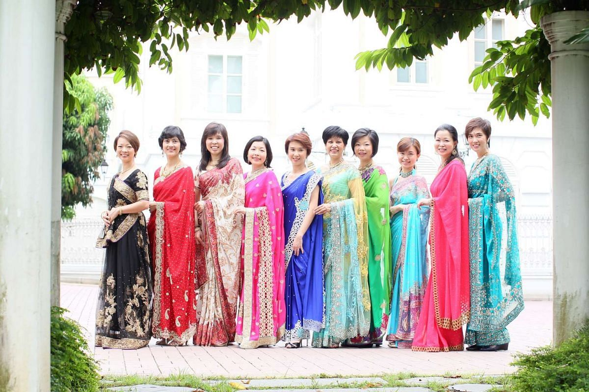 (From left) Ms Foo Mee Har, Ms Joan Pereira, Ms Jessica Tan, Ms Cheryl Chan, Ms Low Yen Ling, Ms Indranee Rajah, Ms Sim Ann, Ms Tin Pei Ling, Ms Cheng Li Hui and Mrs Josephine Teo pose in saris ahead of Deepavali.