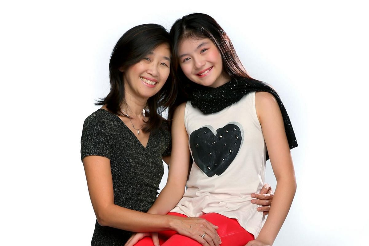 Melissa Wei-En Hecker, 11, with her mum, Ms Bridget Yeo-Hecker.