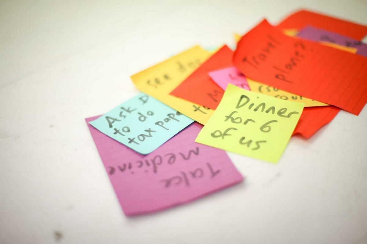 Mrs Teo relies heavily on Post-it notes stuck in prominent places to remind her of daily tasks.