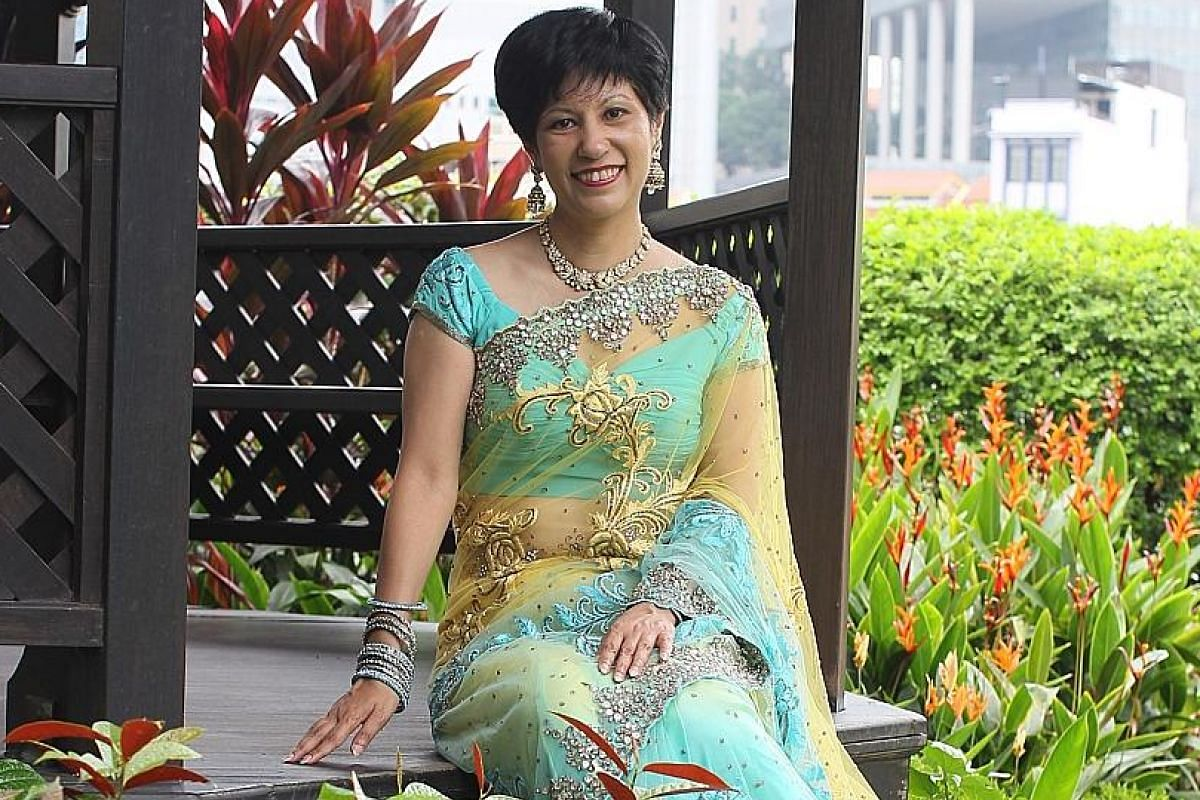 """Ms Indranee, who gathered the group of MPs for the photo shoot, said she felt it was a """"very nice way"""" for the MPs to connect with the Indian community, adding that """"it says something about our multiracialism and the fact that we can be united in so"""
