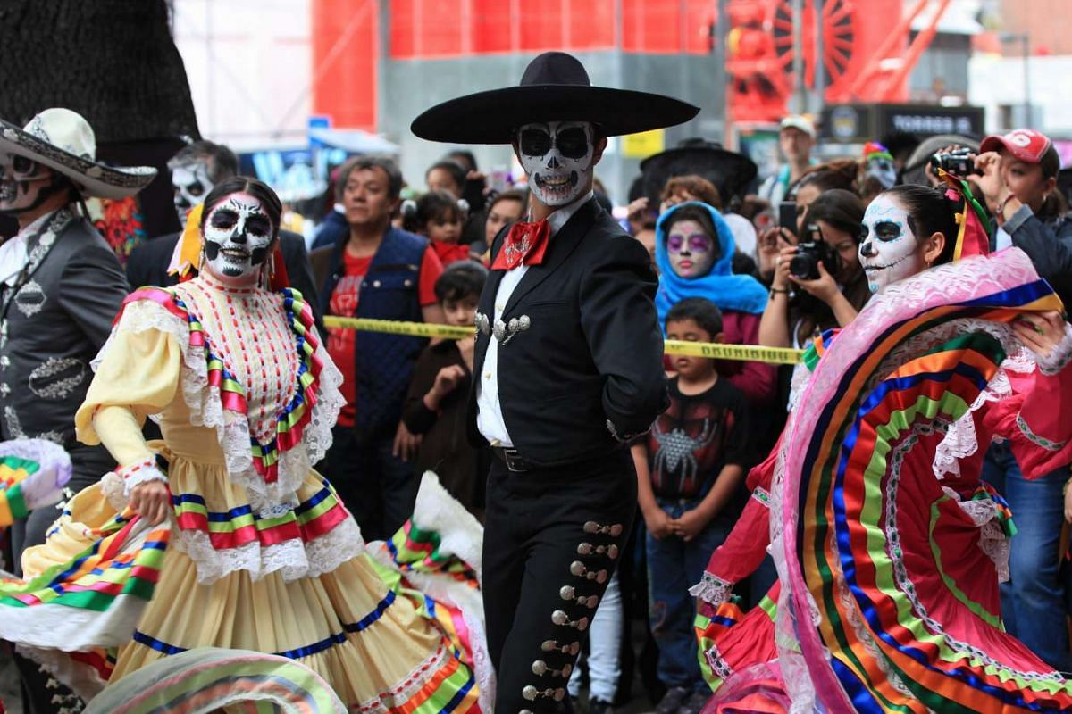 People participate in the third national parade of 'Catrinas and Catrines' traditional Mexican characters, in the streets of Mexico City, on Oct 23, 2016.