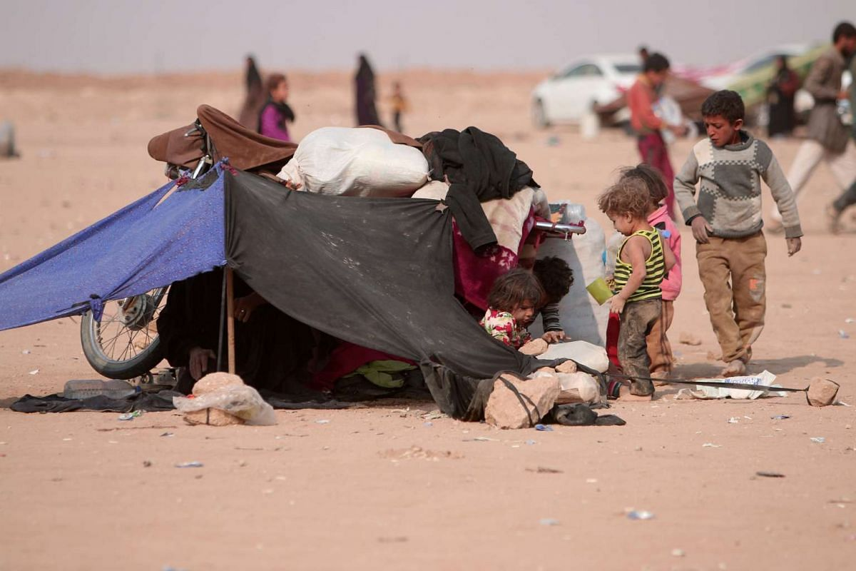 Refugees rest under a makeshift tent, among Iraqi refugees that fled violence in Mosul and internally displaced Syrians who fled ISIS-controlled areas in Deir al-Zor, near the Iraqi border, in Hasaka Governorate on Oct 23, 2016.