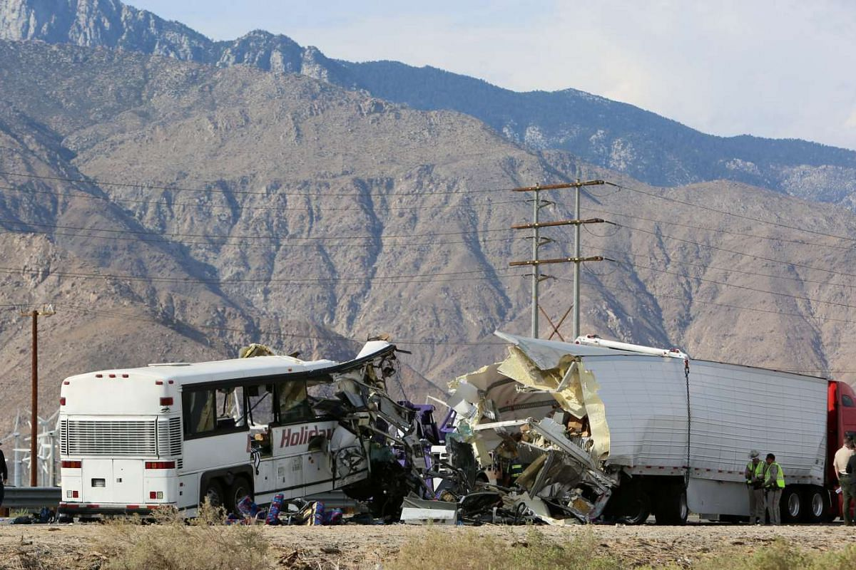 Investigators confer at the scene of a mass casualty bus crash on the westbound Interstate 10 freeway near Palm Springs, California, on Oct 23, 2016.