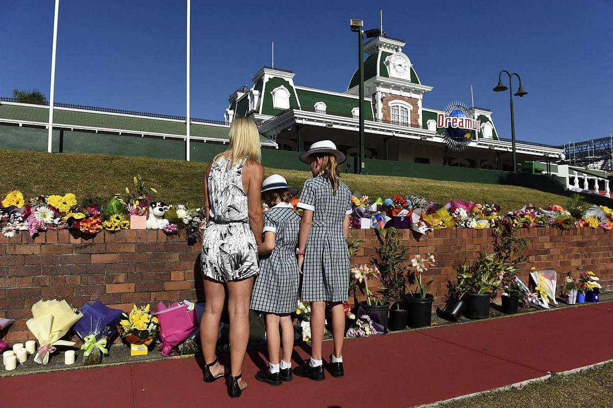 A family pays their respects to four people who died in an accident at the Dreamworld amusement theme park in Gold Coast, Queensland, Australia on Oct 26, 2016.