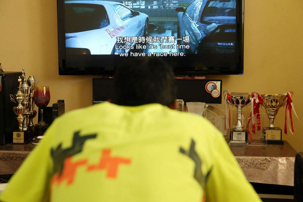"""Trophies won over the years adorn the living room of Feroz's family flat, as he eats his breakfast over Hong Kong action movies, after a morning run. Being a soft-spoken character, """"He does not usually tell us about his races, until he comes back wit"""