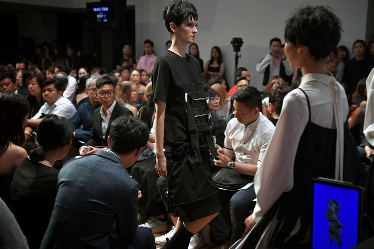 A model walking down the runway wearing a dress designed by Max Tan at the National Gallery Singapore on Oct 26, 2016.