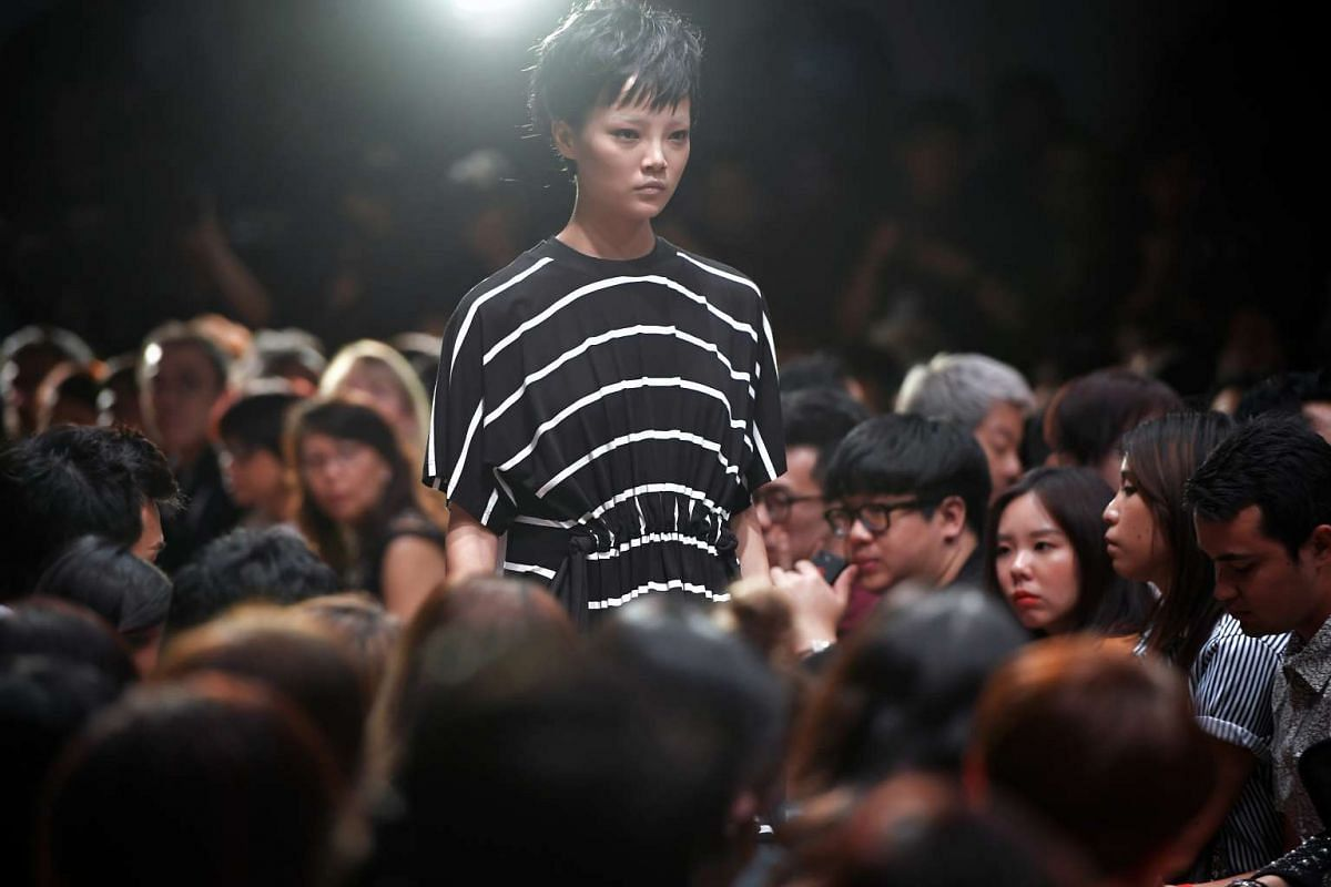 A model walks down the runway in a black and white striped dress designed by Max Tan, at the National Gallery Singapore on Oct 26, 2016.