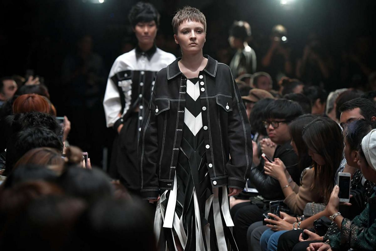 A model wears an outfit designed by Max Tan, in which he has incorporated a masculine black denim jacket and made it look softer as a part of the outfit, at the National Gallery Singapore on Oct 26, 2016.