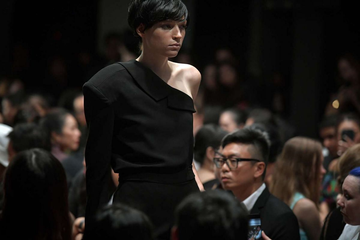 A model presents a black off-shoulder Max Tan design on the runway at the National Gallery Singapore on Oct 26, 2016.