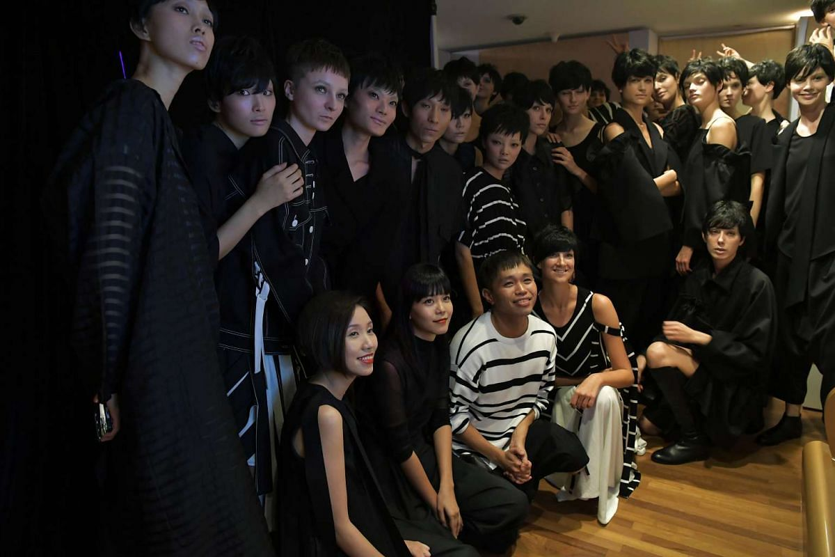 Max Tan posing for a photo with models dressed in his designs at the National Gallery Singapore on Oct 26, 2016.