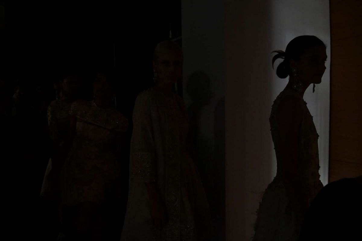 The silhouette of a model in an outfit designed by Guo Pei at the National Gallery Singapore on Oct 26, 2016.