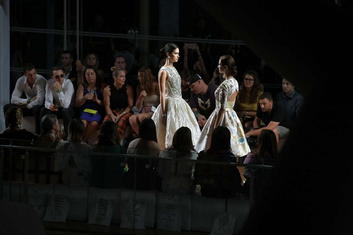 Models present beaded and embroidered Guo Pei designs on the runway at the National Gallery Singapore on Oct 26, 2016.