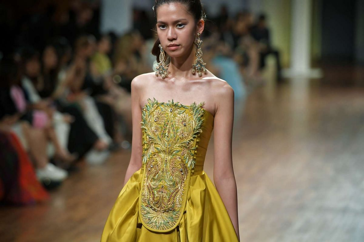 A model wearing a yellow Guo Pei design at the National Gallery Singapore on Oct 26, 2016.
