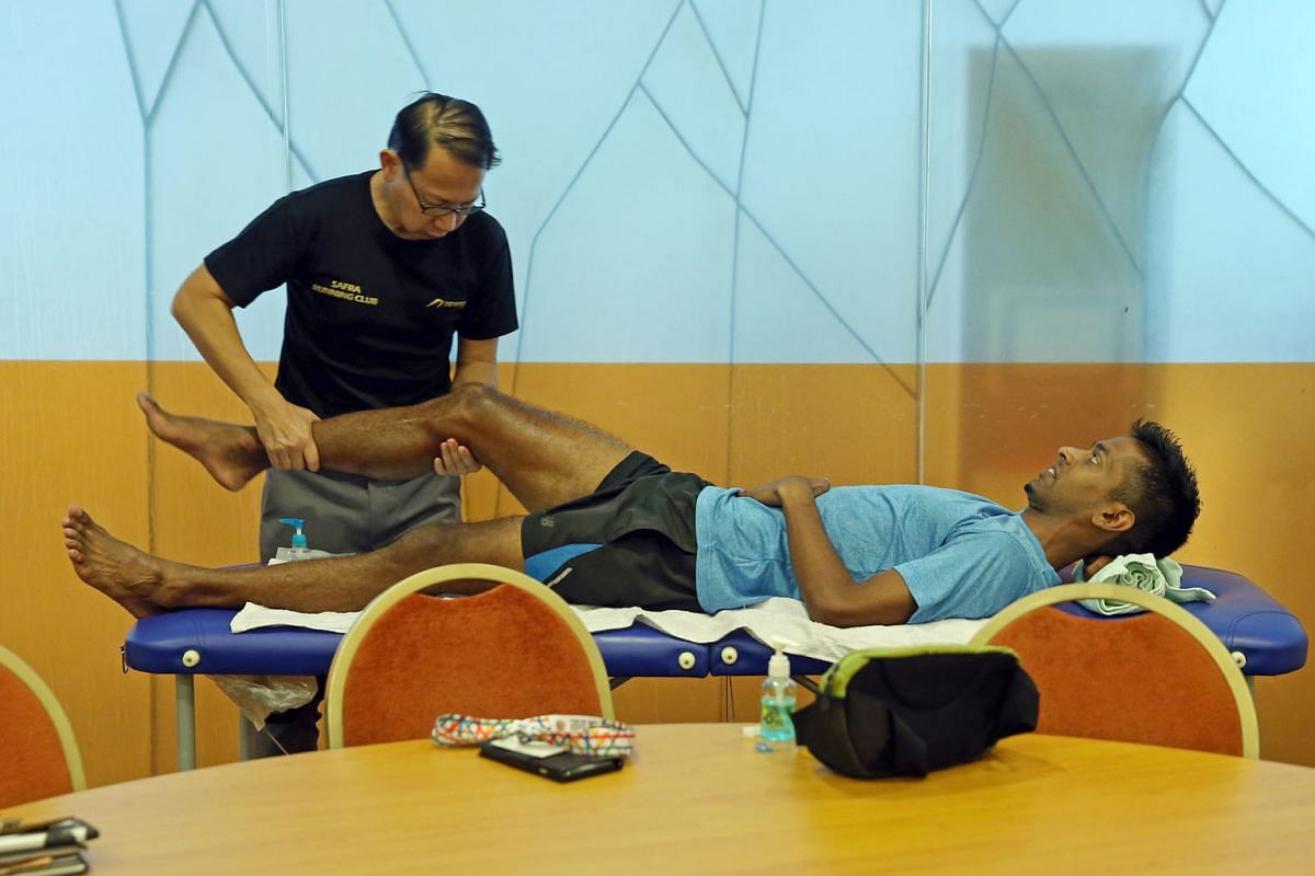 Freelance sports therapist David Shum massages Mr Feroz so his muscles can recover before the next training session. Mr Shum, 48, does not charge Mr Feroz as he knows he quit his job to pursue his dream.