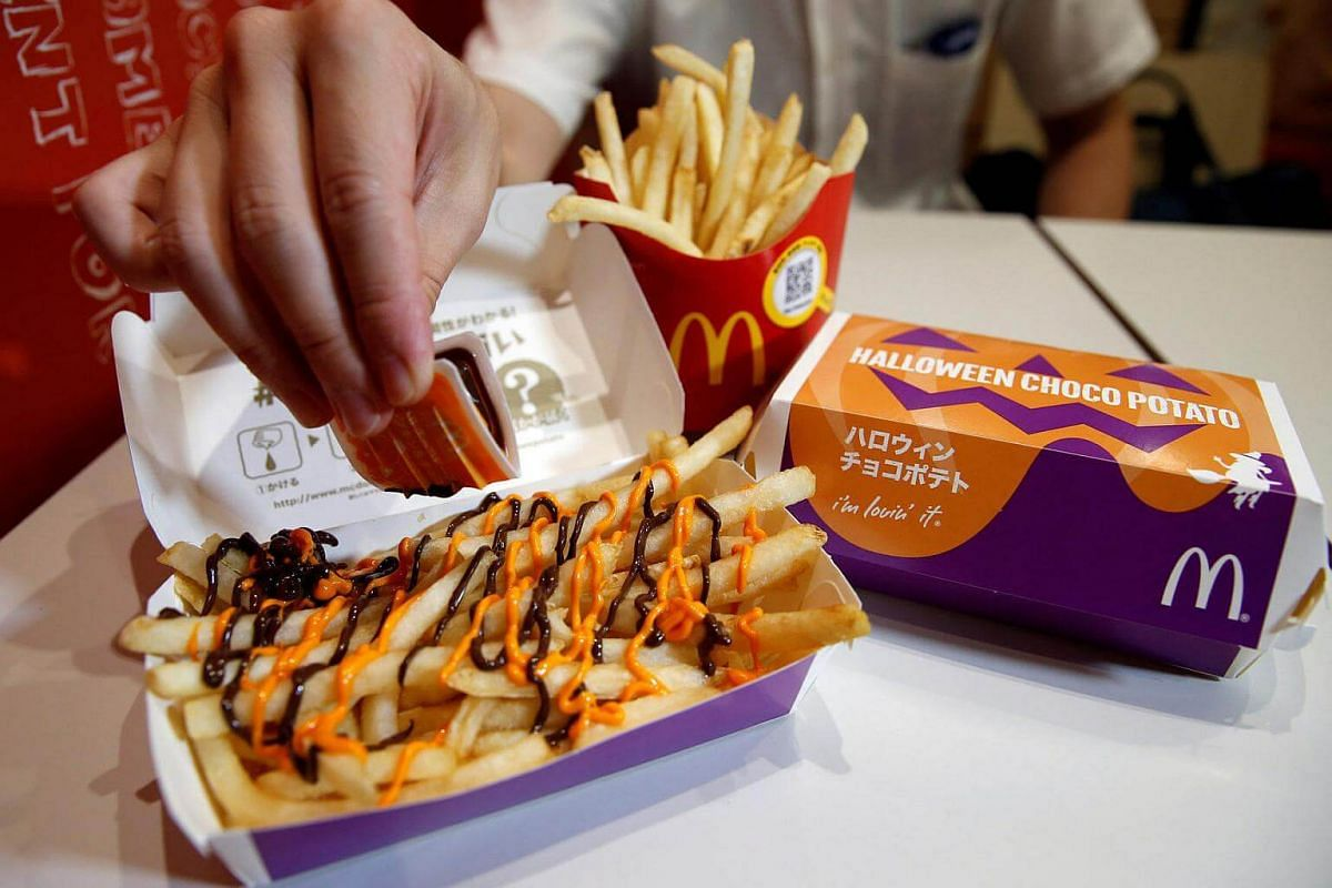 McDonald's 'Halloween Choco Fries - Pumpkin & Choco Sauce' that is McFry Potato served with pumpkin and chocolate sauces, is seen at a McDonald's restaurant in Tokyo, Japan, on Sept 29, 2016.