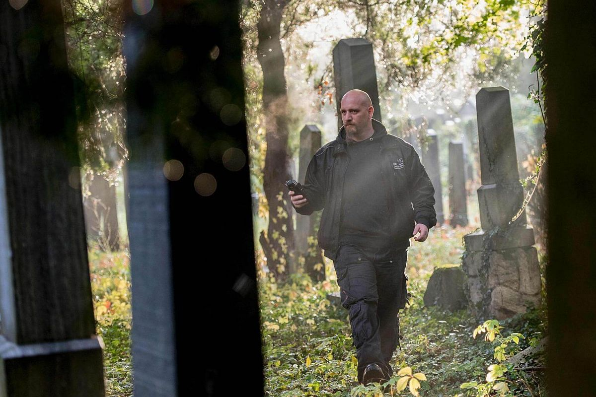 Willi Gabler, the 'Paranormal Investigator' from Vienna Ghosthunters, looks for paranormal activity at Vienna Central Cemetery on Oct 20, 2016.