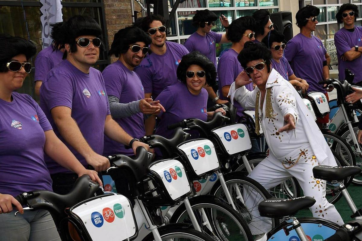 RTC Bike Share general manager Mike Hair (right), dressed as Elvis Presley, poses with a group of bike riders wearing Elvis Presley-themed wigs and sunglasses during the Regional Transportation Commission of Southern Nevada's RTC Bike Share launch ou