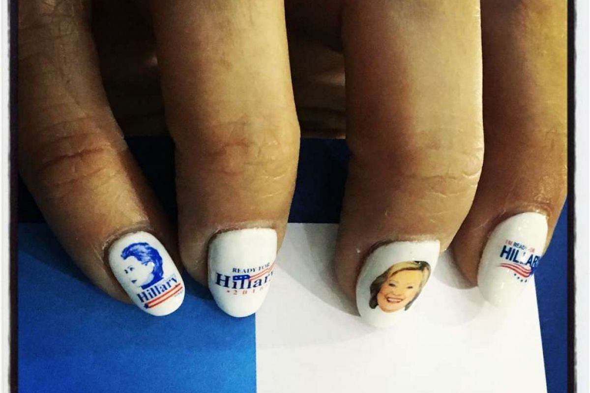 A supporter wears manicured nails with images of Democratic presidential candidate Hillary Clinton during a Women for Hillary Organizing event on June 3, 2016.