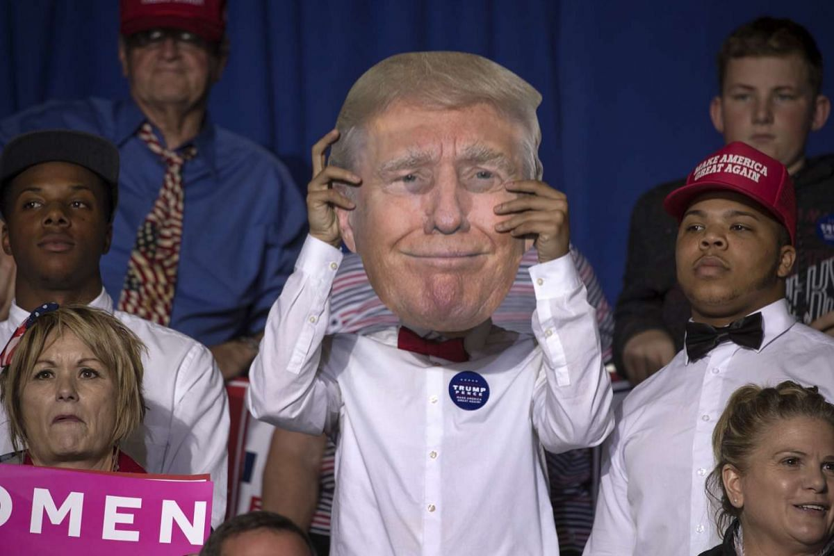 A Donald Trump supporter in the stands during a campaign event in Ohio on Oct 27, 2016.