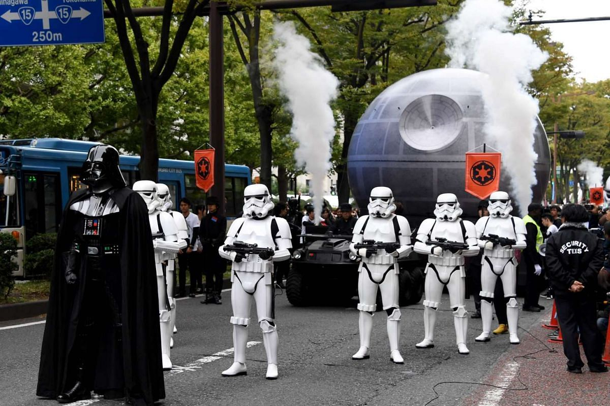 People dressed as Darth Vader and storm troopers lead the Star Wars parade during the Kawasaki Halloween event in Kawasaki city on Oct 30, 2016.