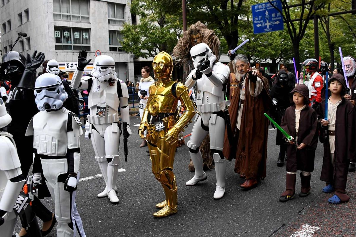 People in costume join the Star Wars parade during the Kawasaki Halloween event in Kawasaki city on Oct 30, 2016.